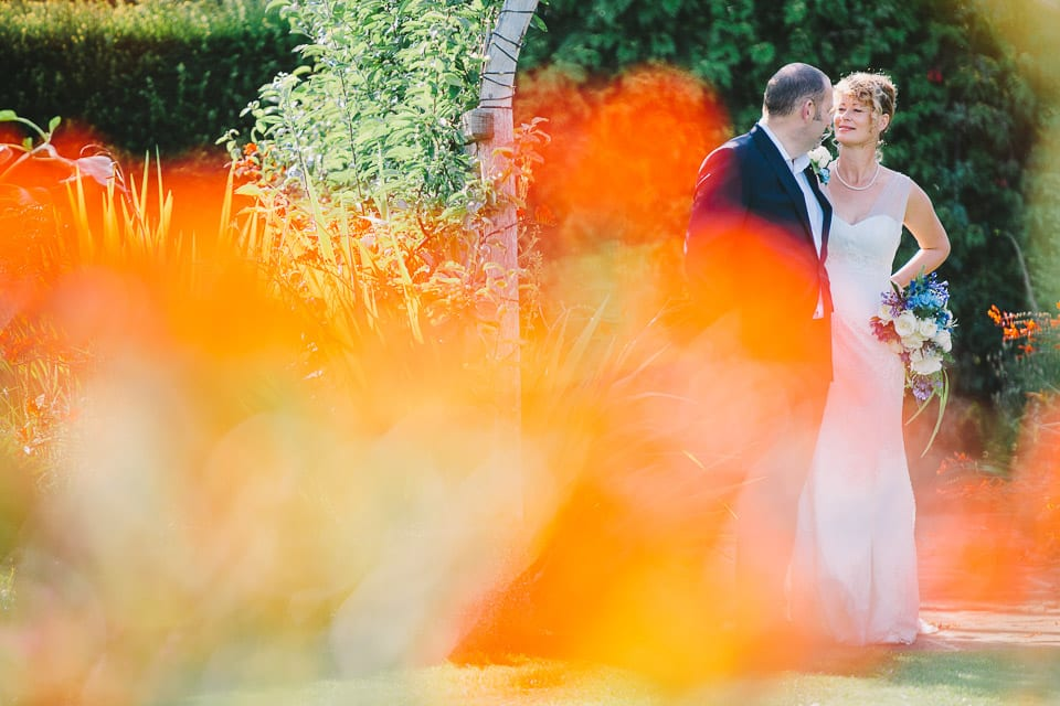 Bride and groom in the gardens of Whatley Manor