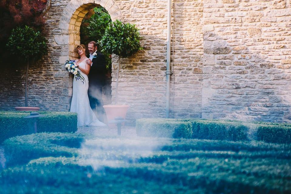 Bride and groom in walled garden