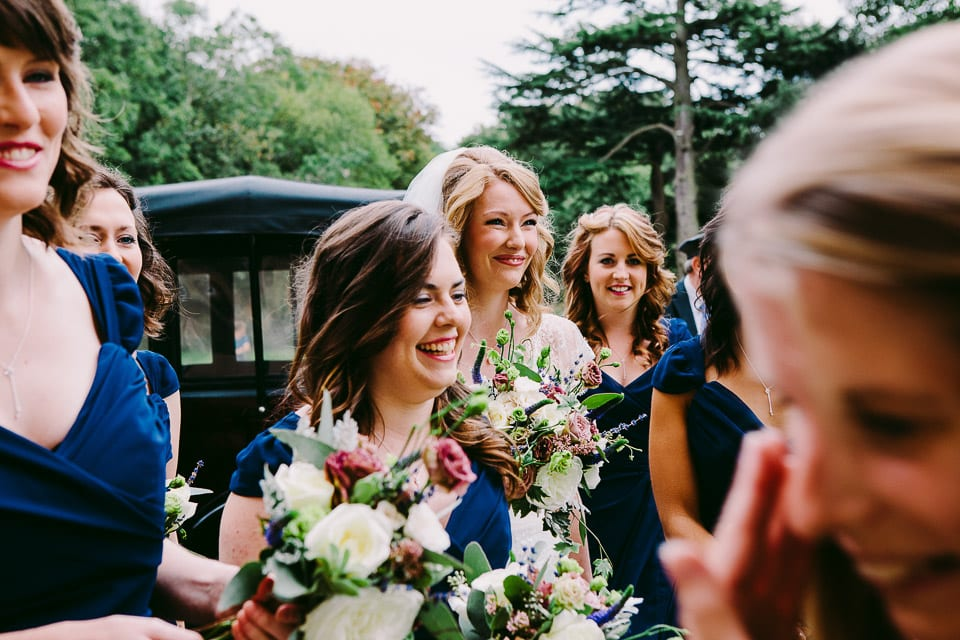The bride and bridesmaids arrive in style at the venue