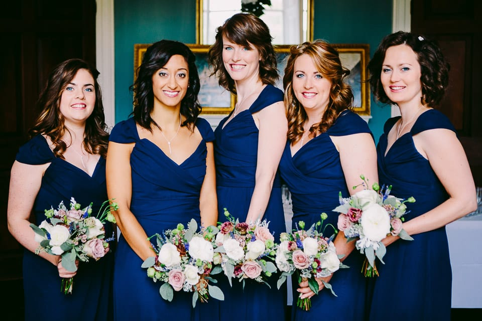 The bridesmaids line up for a photograph