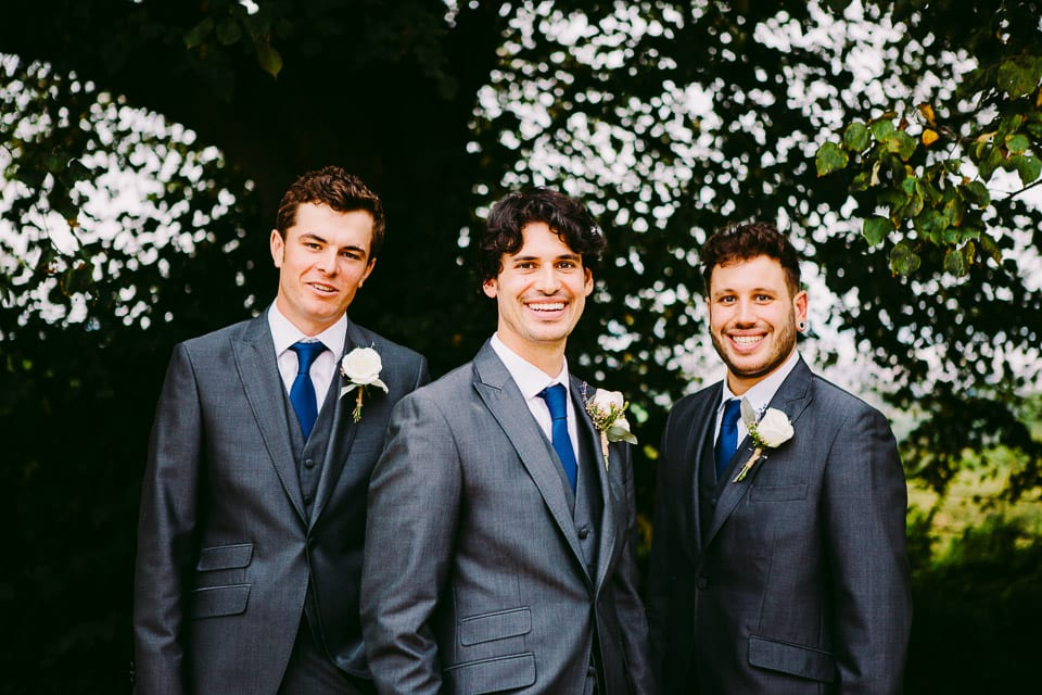 The groom and his groomsmen lined up for a portrait