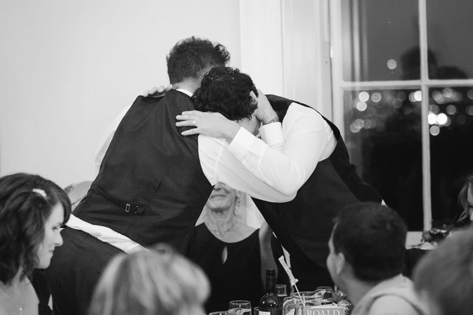 The groom hugs his brother during the speeches