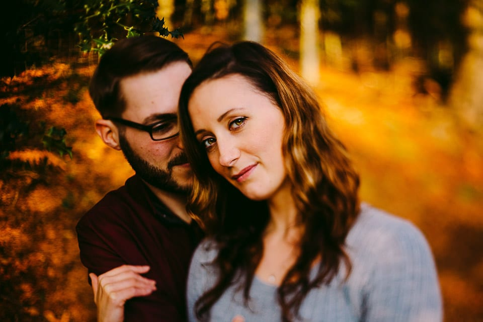 Autumn portrait of an engaged couple in Woodchester Park