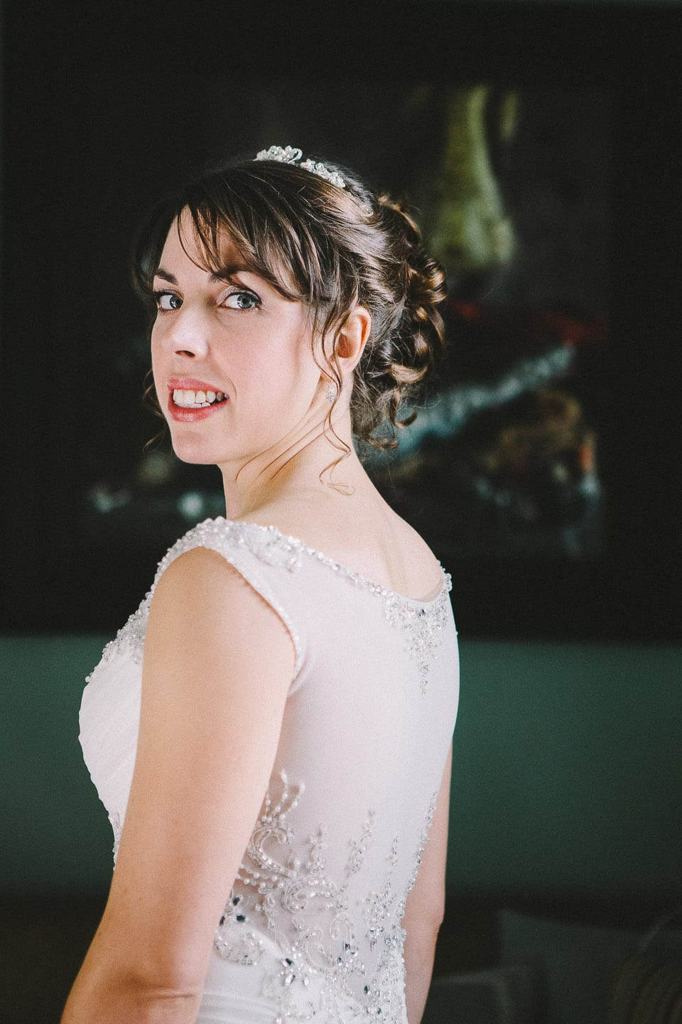 Beautiful bride looking back over her shoulder at Bowood Golf and Country Club