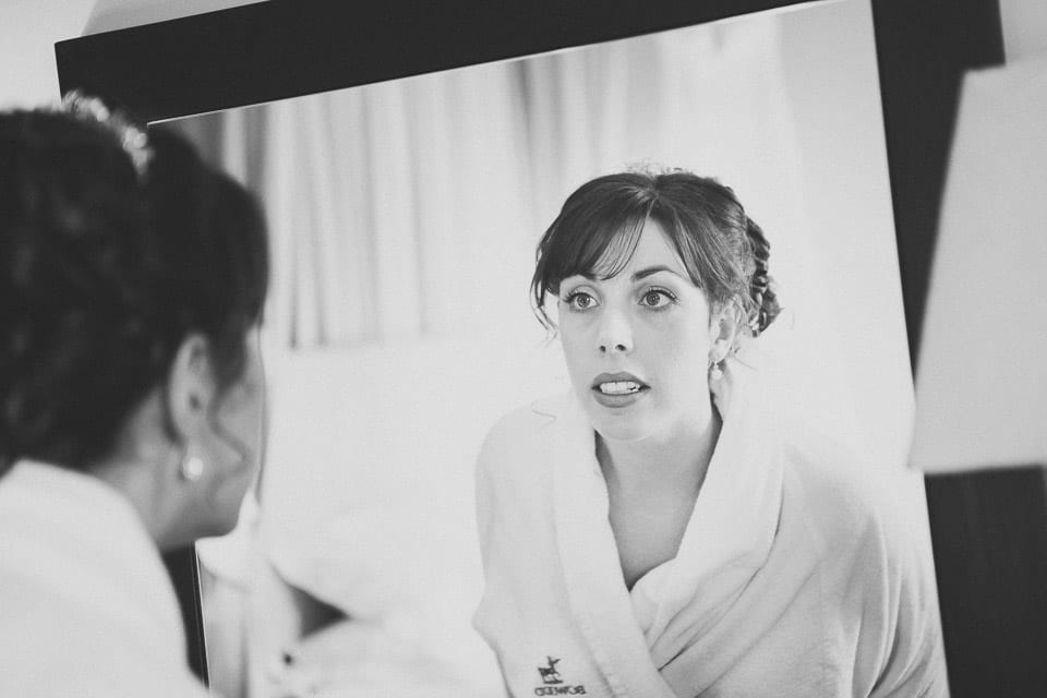 Bride checking out her make up in the mirror
