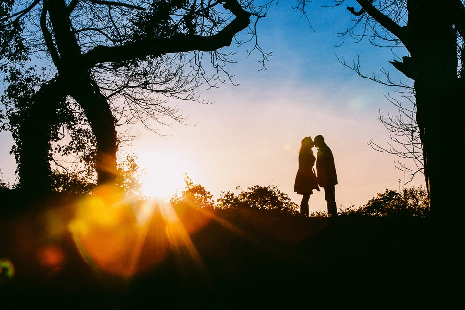 Sunset silhouette of engaged couple at Clifton near Bristol