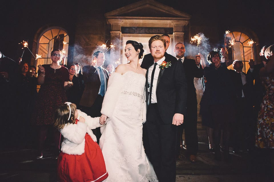 Bride and groom and their guests with Sparklers outside Kings Weston House