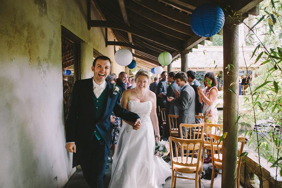bride and groom lead their guests from the ceremony at Matara