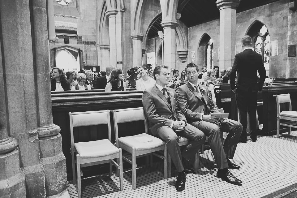 Groom and best man seated in Christ Church