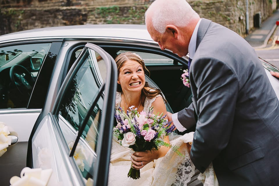 Father of the bride helping her out of the car at Christ Church