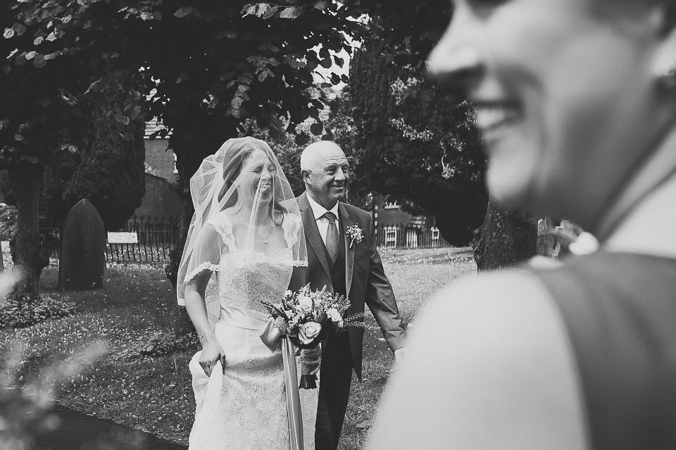 Bride and her father walking up the path to the church