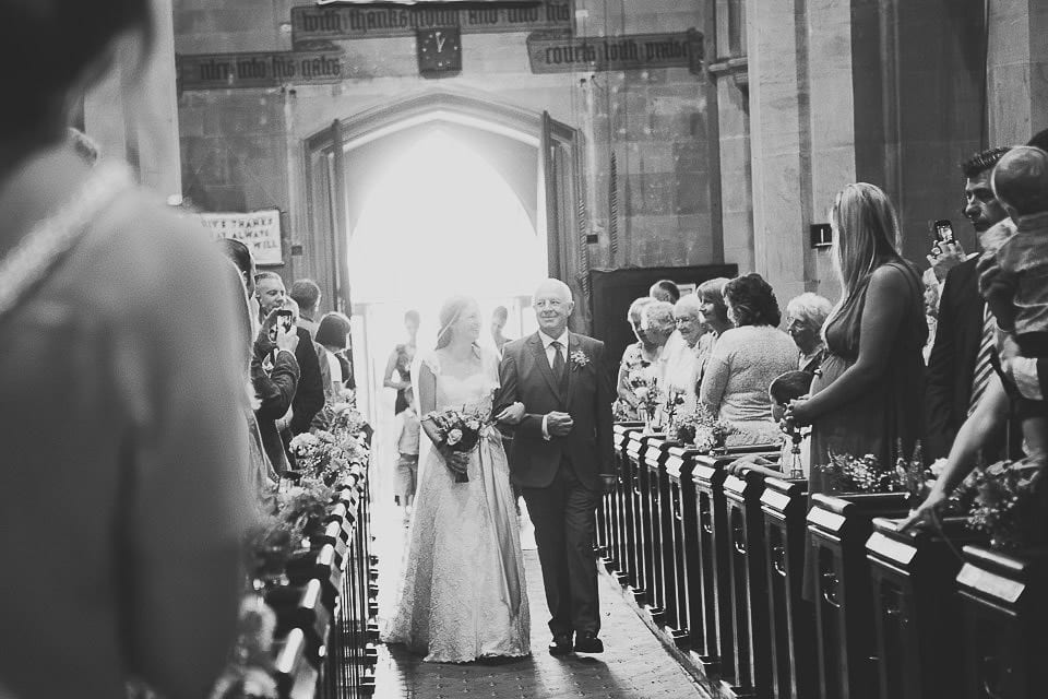 Bride and her father walking up the aisle in Christ Church