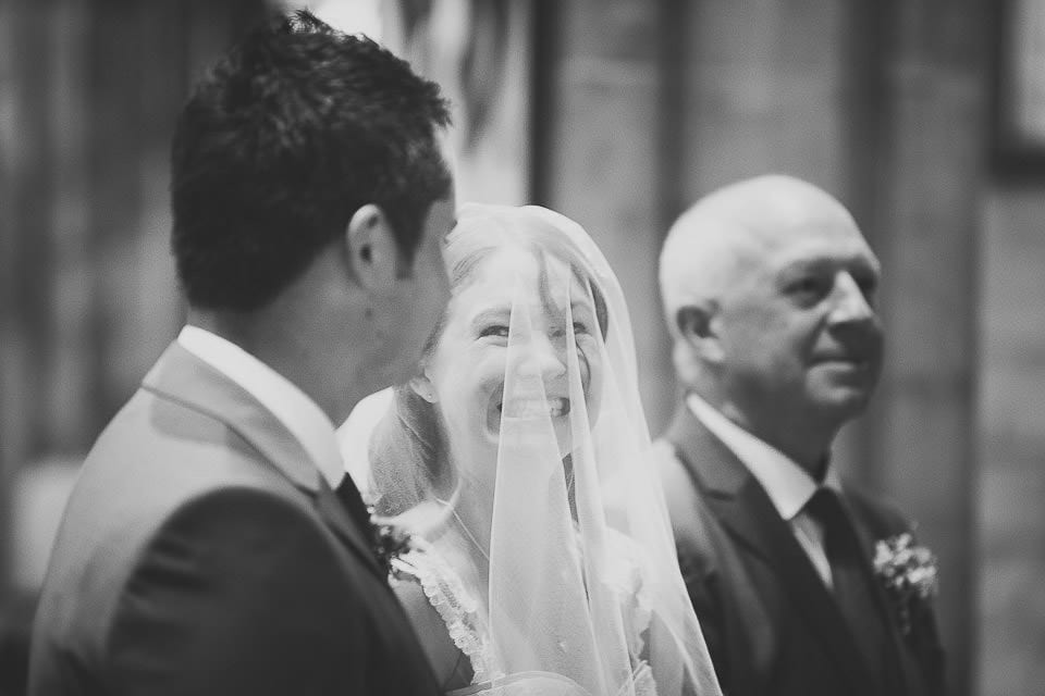 Bride looking excitedly at the groom during the wedding ceremony