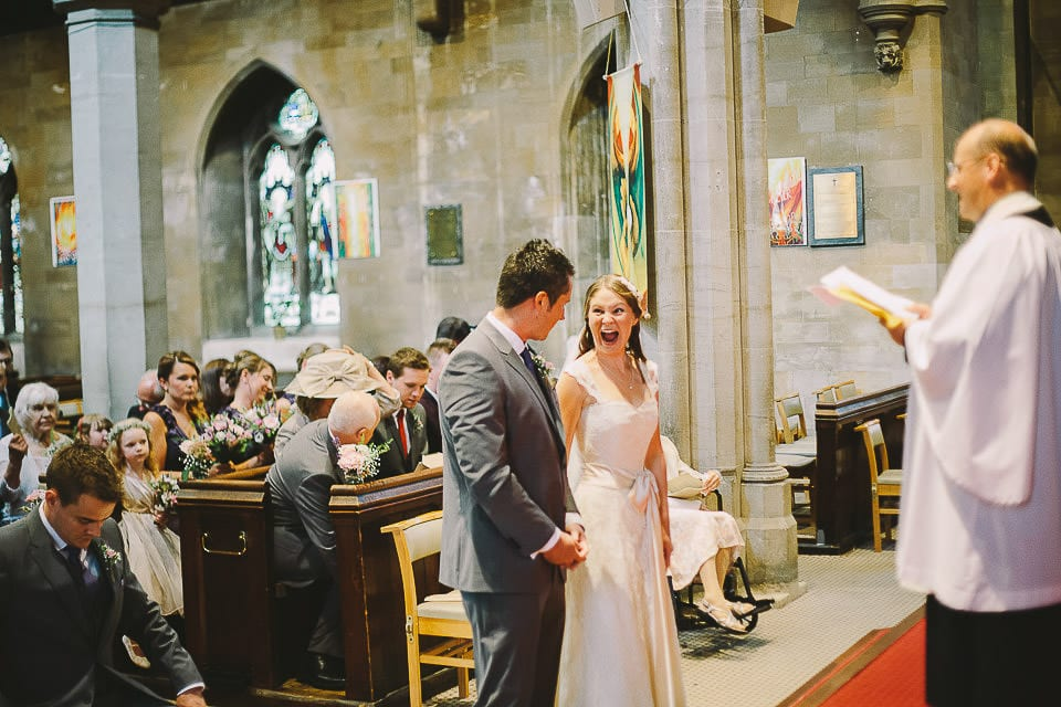 Bride looking excited in church during ceremony