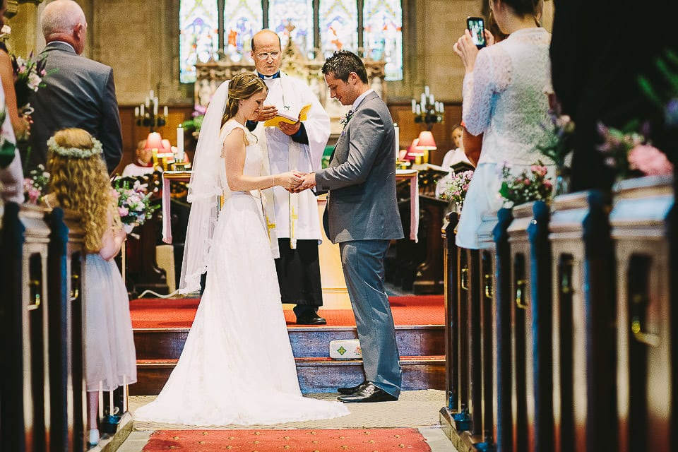 Bride and groom exchange wedding rings in Christ Church