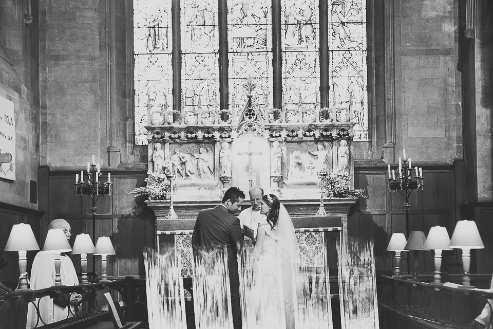 Reflection shot of the bride and groom at the altar in Christ Church