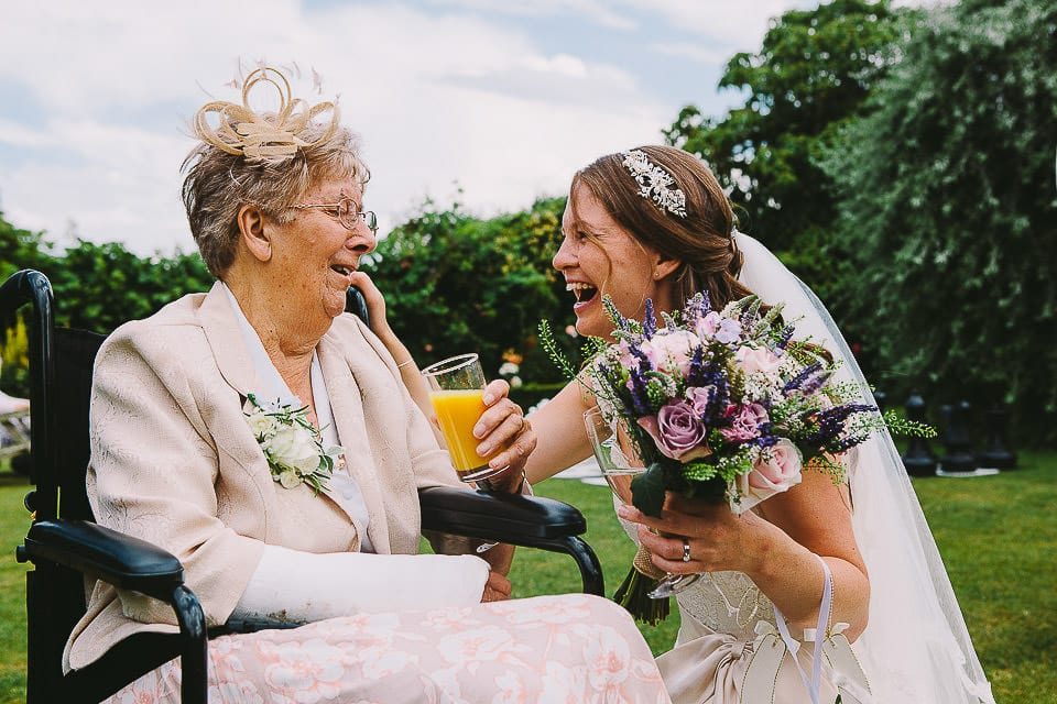 Bride and her grandmother in the gardens at Abbey House Gardens