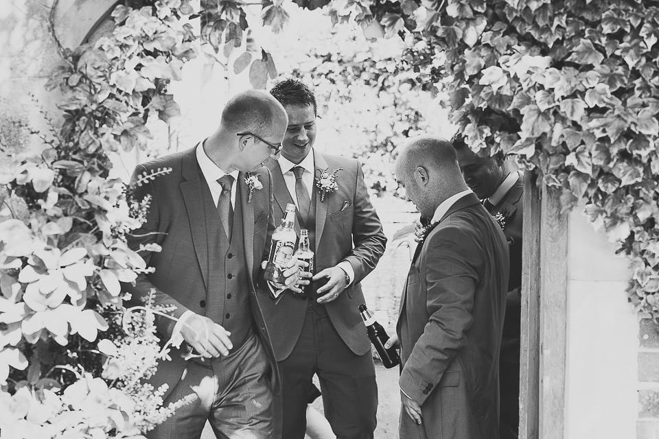 Groom and his groomsmen enjoying a beer together at Abbey House Gardens