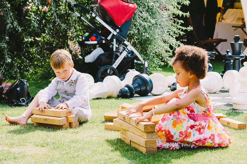 Young guests playing giant Jenga at Abbey House Gardens