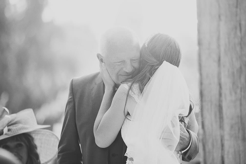 Bride hugs her father after his speech at Abbey House Gardens