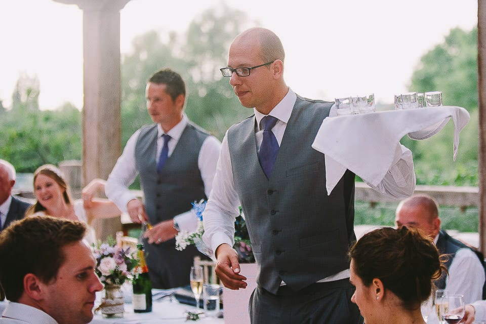 Groom and groomsman during the speeches at Abbey House Gardens