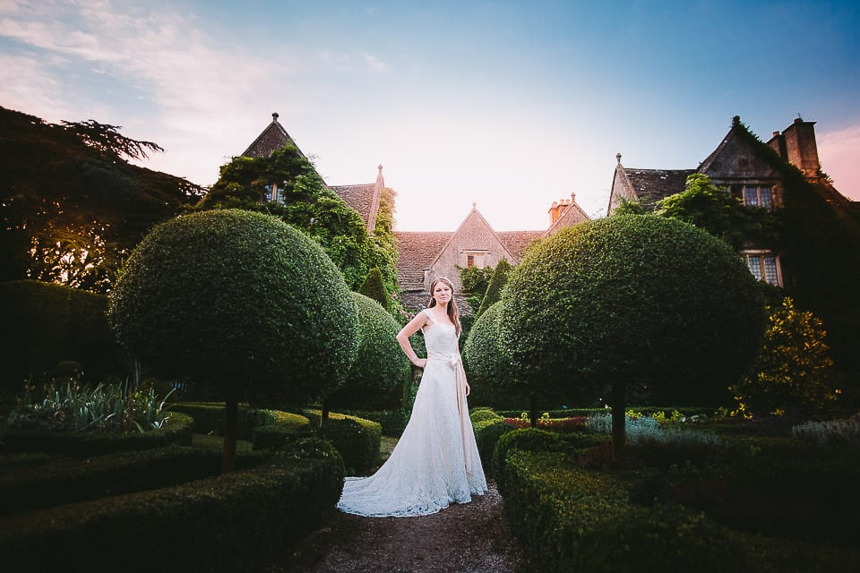 Full length portrait of the bride at sunset in the grounds of Abbey House Gardens