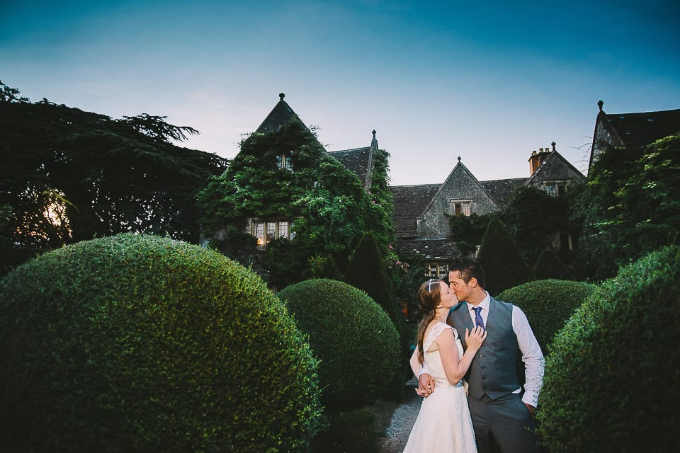 Bride and groom in the grounds with Abbey House in background