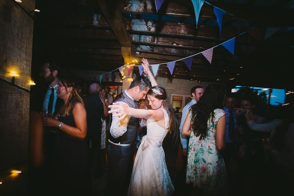 Bride and groom dancing with their guests at Abbey House Gardens