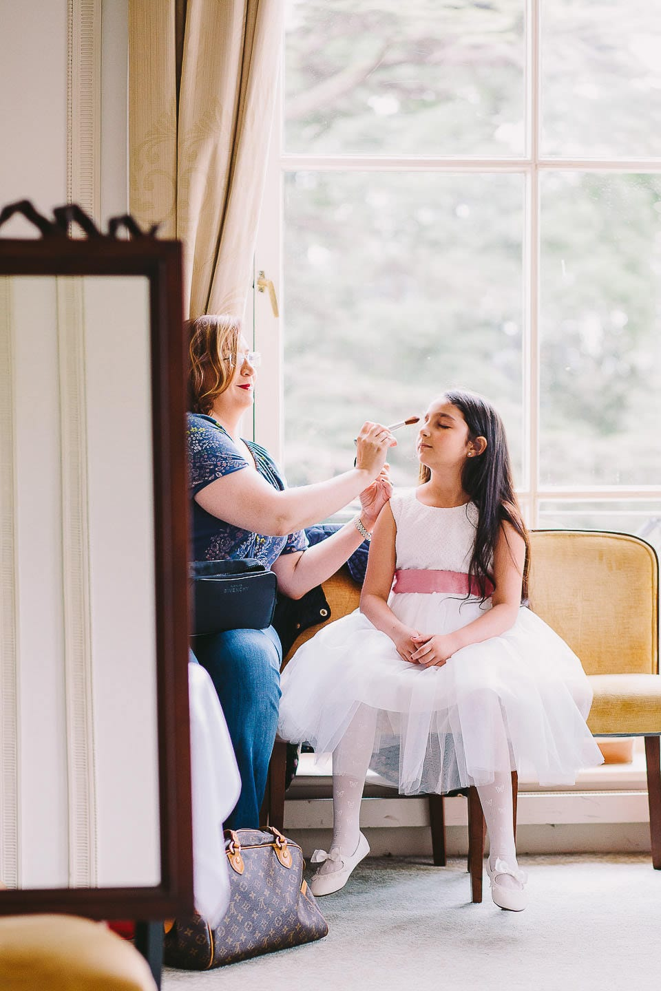 Bridesmaid having her hair accessory attached at Bath Spa Hotel