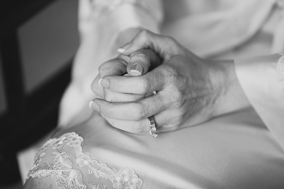 Black and white close up of bride holding her hands in her lap at Bath Spa Hotel