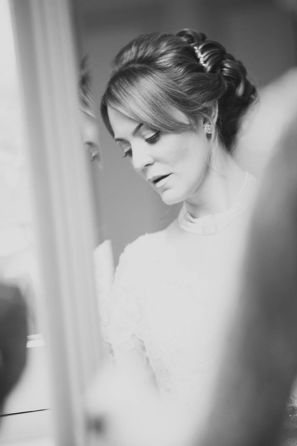 Black and white reflection of the bride in the mirror at Bath Spa Hotel