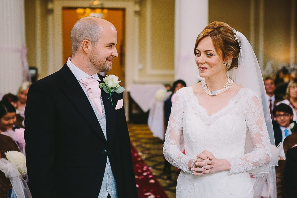 Bride and groom looking at each other during ceremony at Bath Spa Hotel