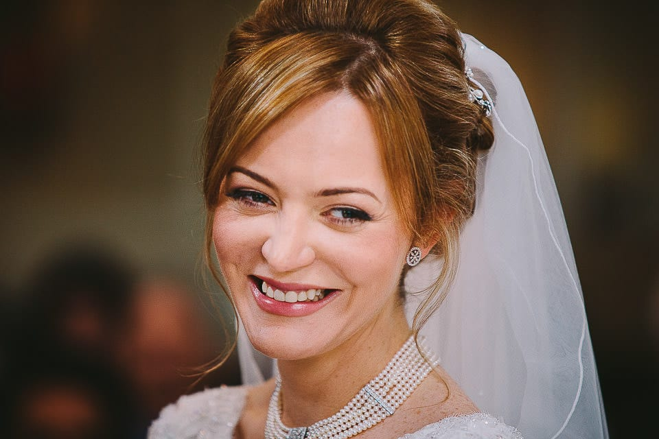 Close up portrait of bride during the wedding ceremony at Bath Spa Hotel