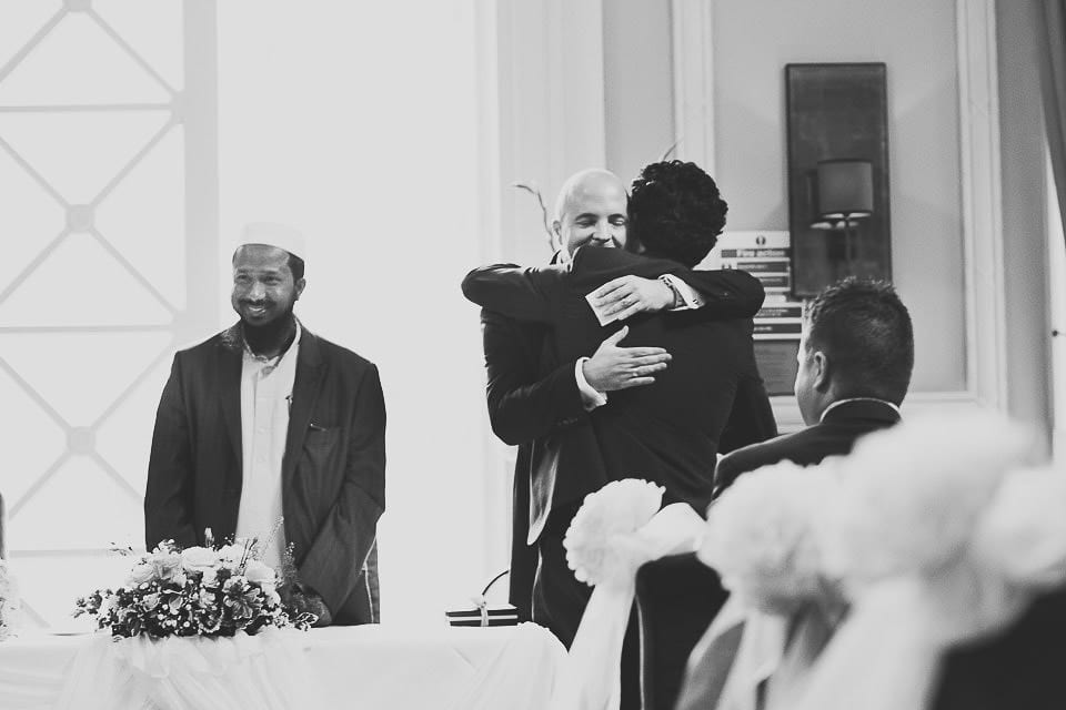 Groom hugging brides family during Islamic ceremony at Bath Spa Hotel