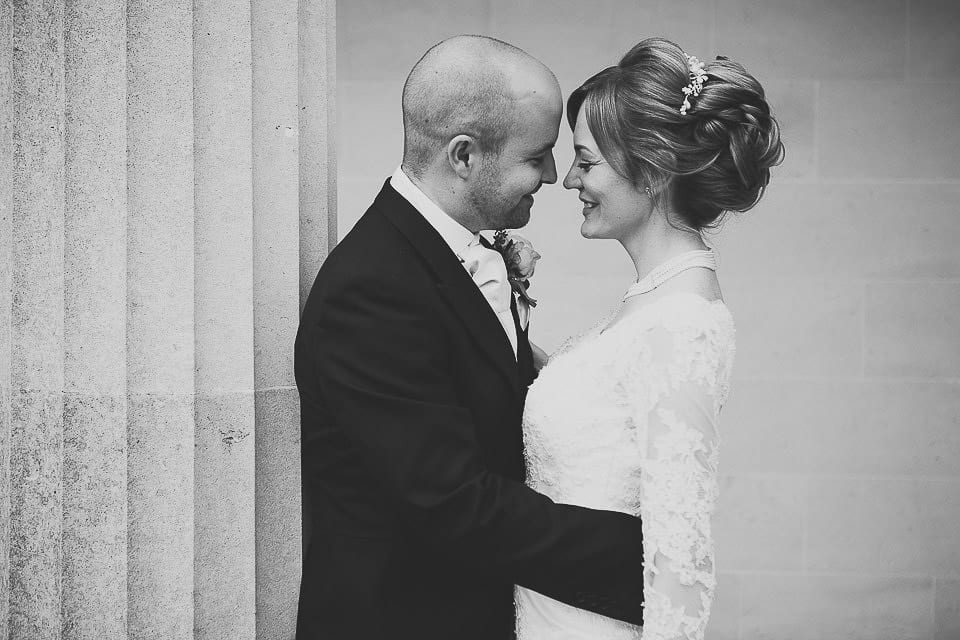 Black and white portrait of bride and groom outside at Bath Spa Hotel
