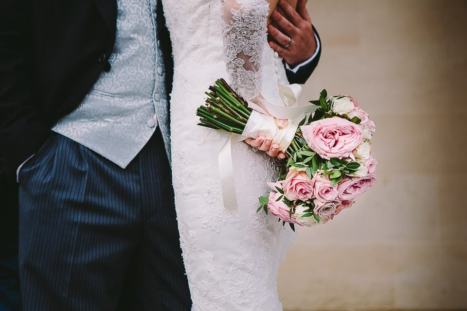 Close up view of the bride holding her bouquet by her side at Bath Spa Hotel