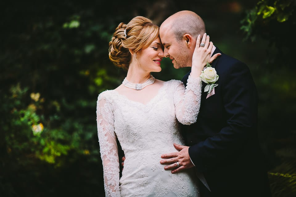 Portrait of the bride and groom in the grounds at Bath Spa Hotel