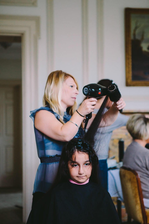 Young bridesmaid having her hair done at at Bath Spa Hotel