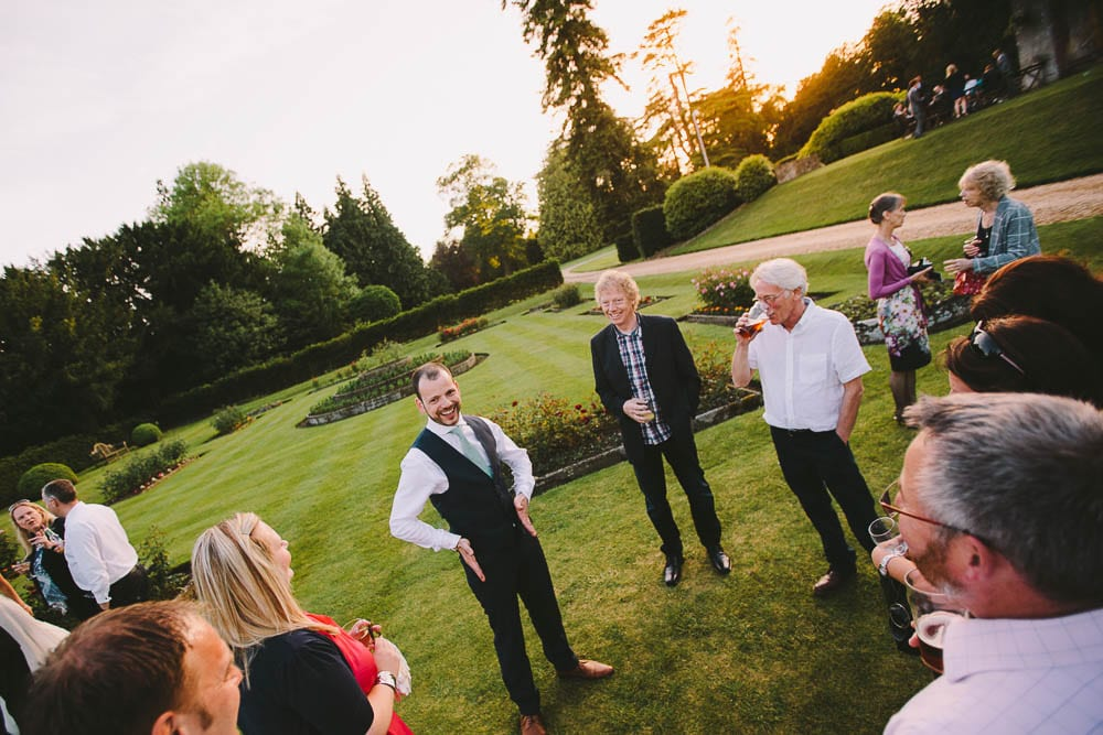Groom and some guests in the gardens at Grittleton House