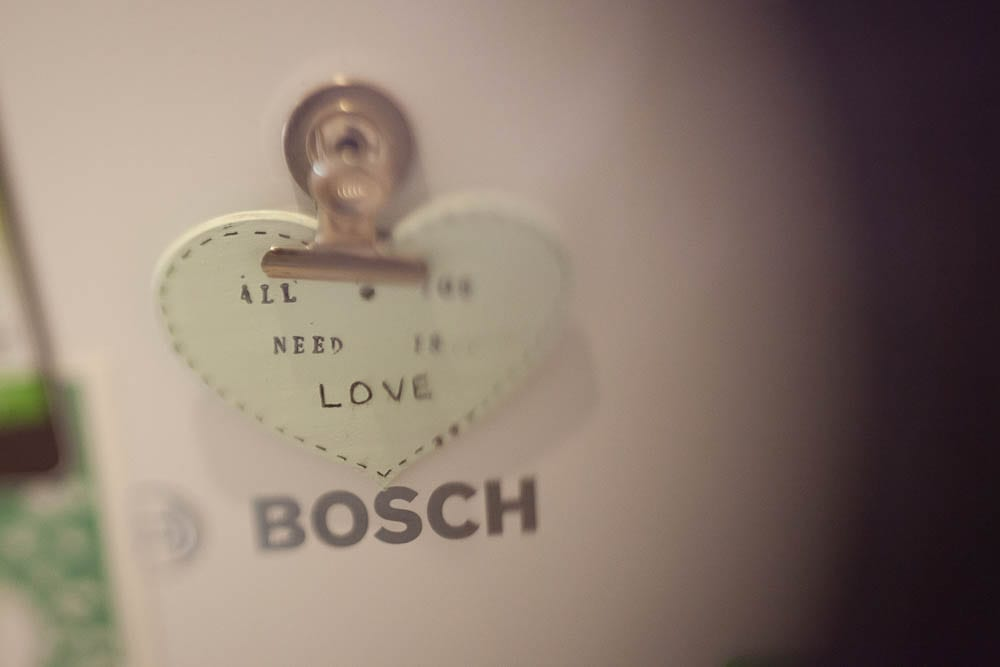 Close up of heart fridge magnet 'all you need is love'