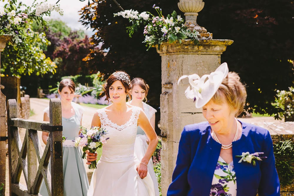 Bride and bridesmaids walking up the path to Great Somerford Church