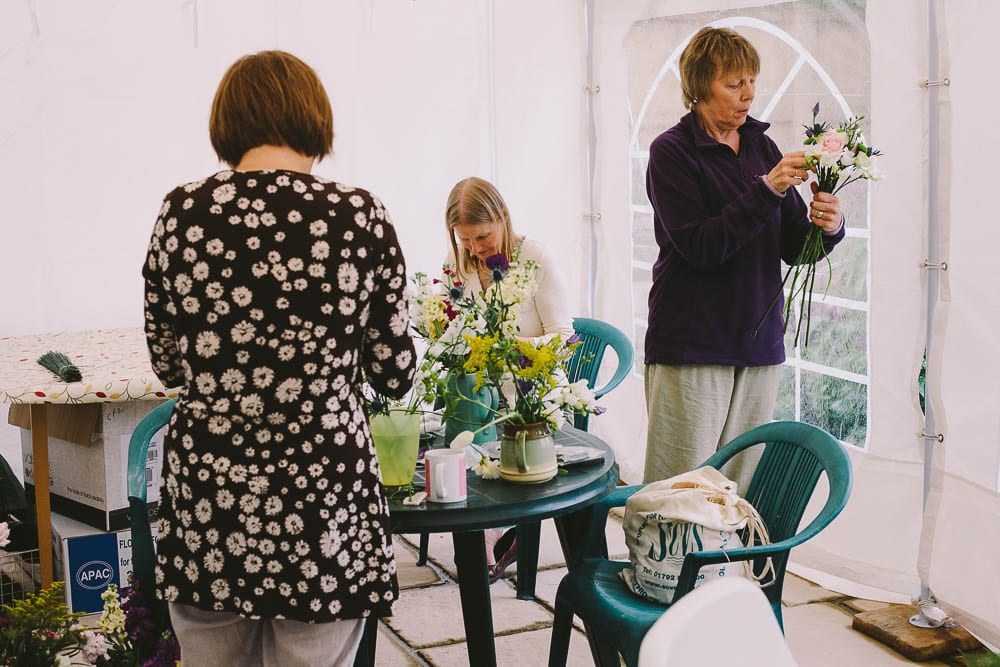 Flower arranging being done in the conservatory