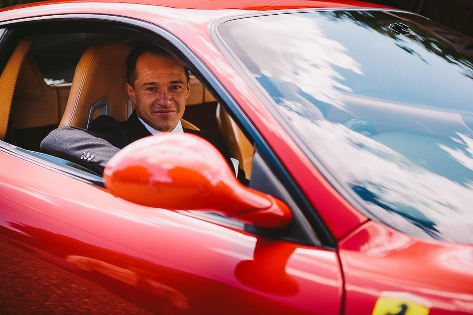 Groom at the wheel of his Ferrari outside Sopley Mill