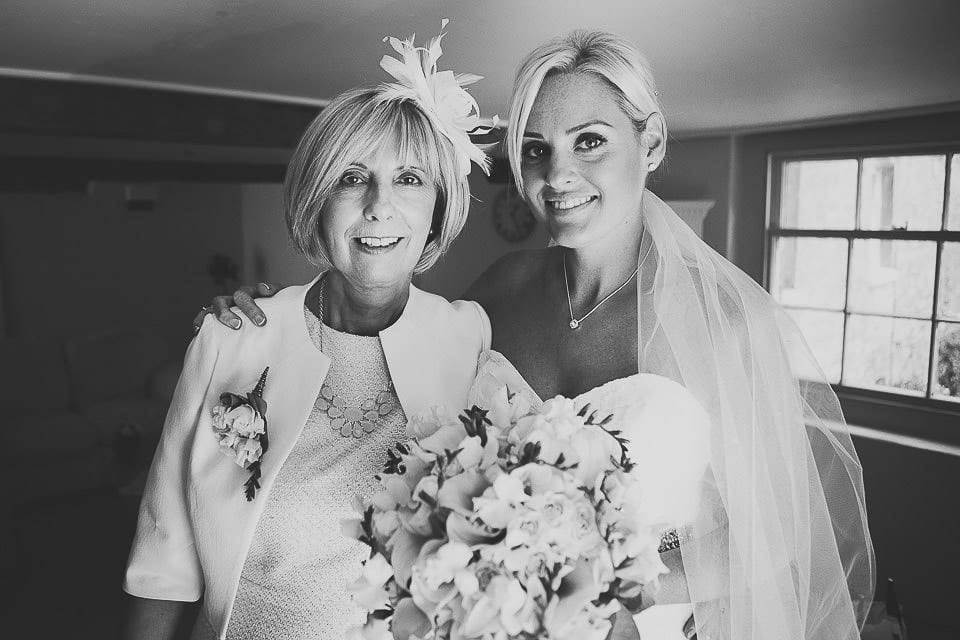Black and white portrait of bride and her mother before ceremony at Sopley Mill
