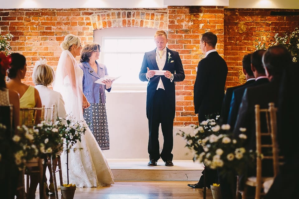 Guest giving a reading during the wedding ceremony at Sopley Mill