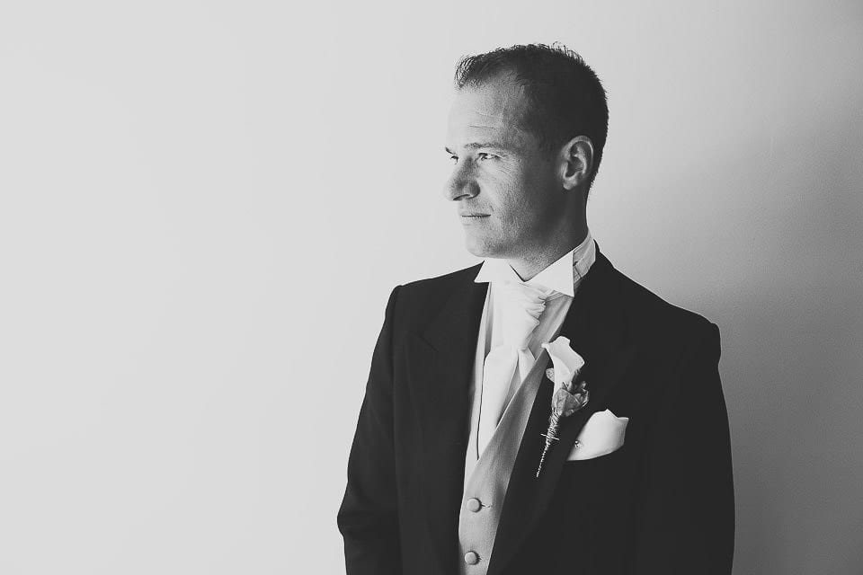 Black and white portrait of the groom at Sopley Mill