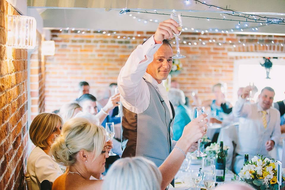 Groom raises a toast to the bride at Sopley Mill