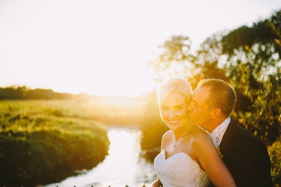 Sunset portrait of the bride and groom in the gardens at Sopley Mill
