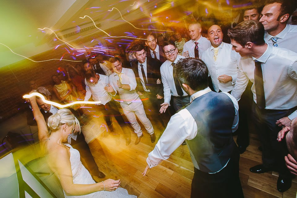 Surprise dance for the bride by the groom and his friends at Sopley Mill