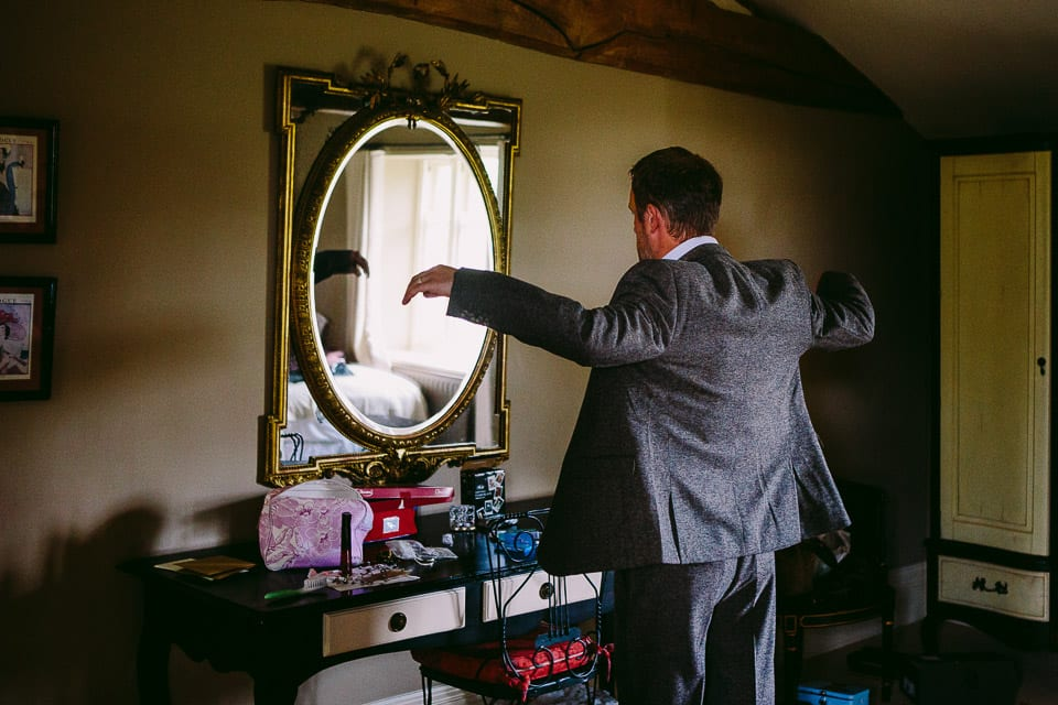 Best man trying on his suit